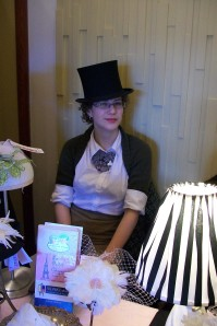 Sara at a bridal show in a vintage pop up top hat.